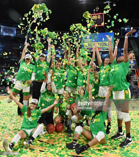 The Oregon Ducks throw confetti in the air as they celebrate their 89-56 victory over the Stanford Cardinal to win the championship game of the...