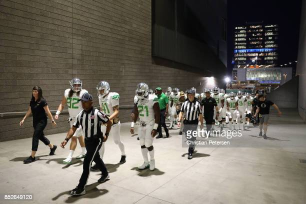 The Oregon Ducks walk out onto the field before the college football game against the Arizona State Sun Devils at Sun Devil Stadium on September 23...