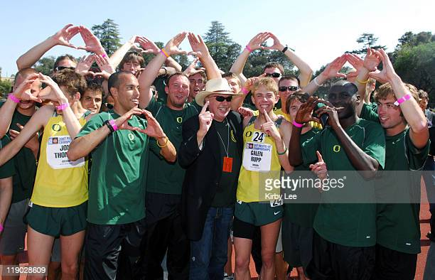The Oregon men pose with Nike founder Phil Knight after winning the team title in the Pacific10 Conference Track Field Championships at Stanford...