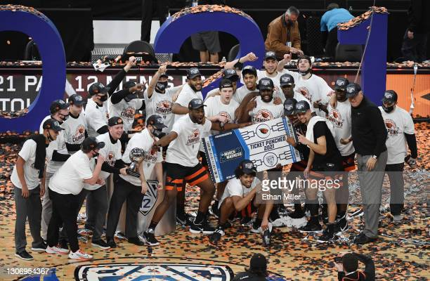 The Oregon State Beavers celebrate their 70-68 victory over the Colorado Buffaloes to win the championship game of the Pac-12 Conference basketball...