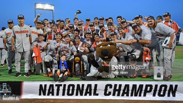 The Oregon State Beavers pose for a team photo and celebrate after defeating the Arkansas Razorbacks for the National Championship during the College...
