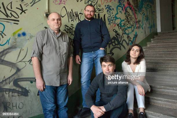 The organisers of the street art festival Yevgeniy Fateyev Konstantin Rachmanov Andrej Kolokolov and Anna Klez photographed in the center of...