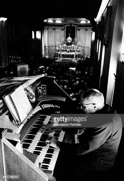 The organist of Saint Francis Church accompanying the mass for Italian immigrants Melbourne 1967