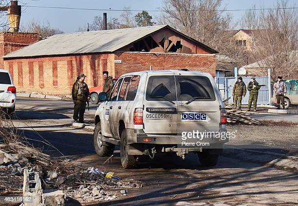 The Organization for Security and Cooperation in Europe monitors the area as fighting continues on February 14 2015 in Donetsk Ukraine Missiles fired...