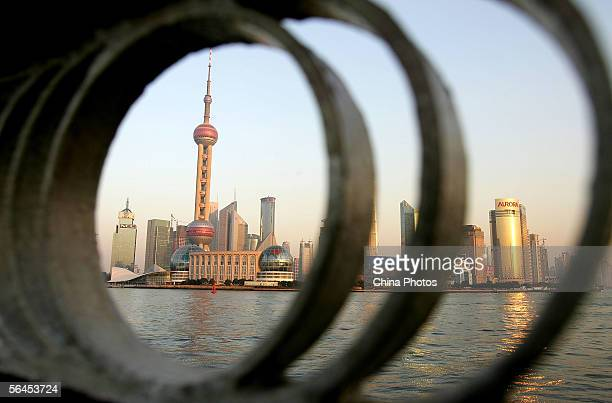 The Oriental Pearl Tower and skyscrapers along the Huangpu River are framed in a fence December 16 2005 in Shanghai China Shanghai Mayor Han Zheng...