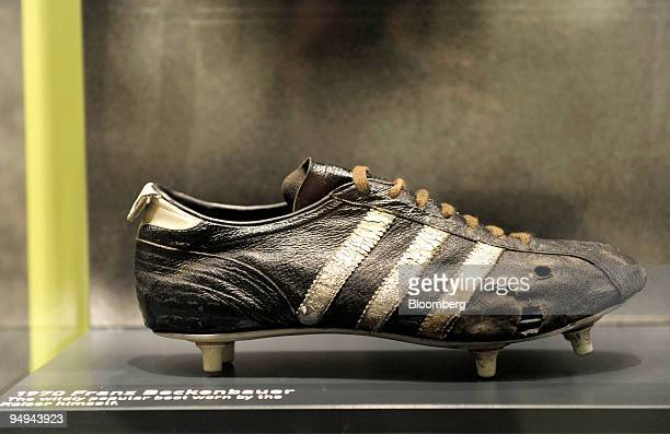 The original Adidas football boot worn by Germany's Franz Beckenbauer in 1970 sits on display during the presentation of the company's 2008 results...