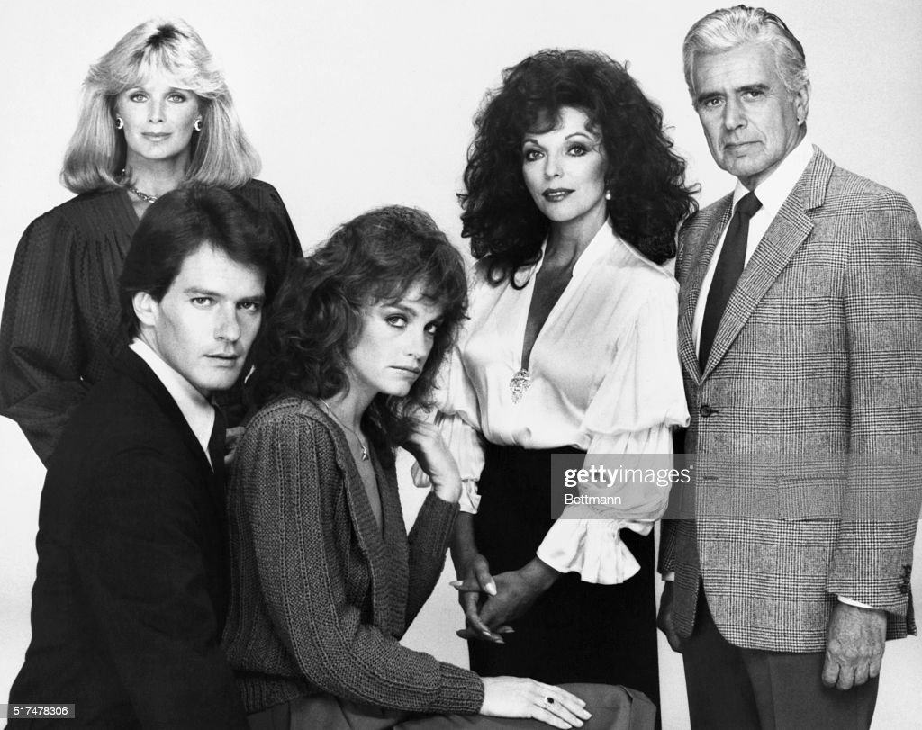 The original cast from the popular and long-running TV series Dynasty. Left to right (back), Linda Evans, Joan Collins, and John Forsythe. Seated, Pamela Sue Martin and Gordon Thomson. ca. 1980s.