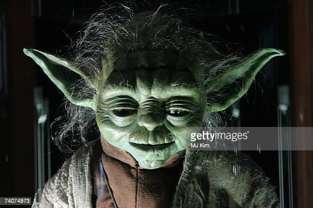 The original costumes for Star Wars character Yoda stand on display at 'Star Wars The Exhibition' at County hall on May 04 2007 in London England
