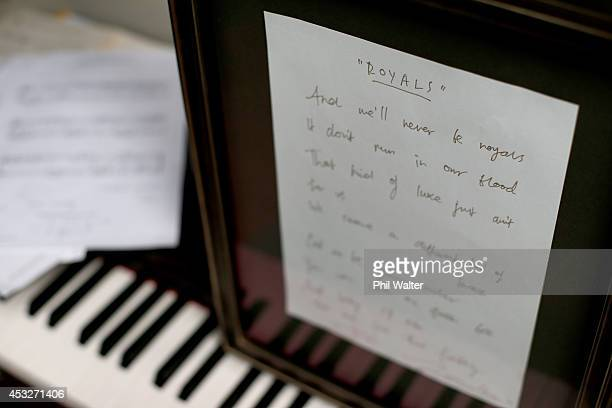 The original handwritten lyric sheet of 'Royals' signed and composed by New Zealand musician Lorde and cowriter Joel Little are seen on August 7 2014...