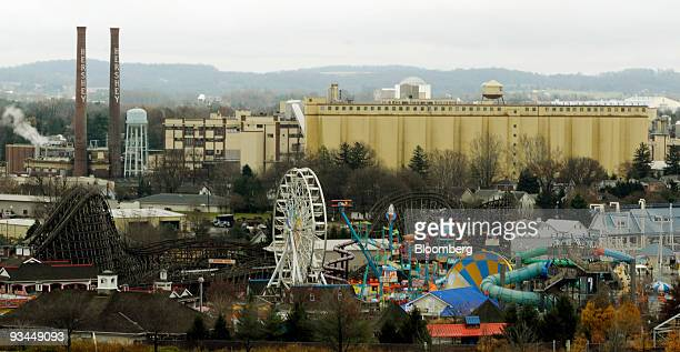 The original Hershey Co chocolate manufacturing plant and Hershey Park Entertainment facility foreground stand in Hershey Pennsylvania US on...