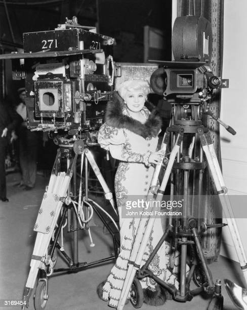 The original Hollywood sex symbol Mae West behind the scenes of the film 'Belle of the Nineties' directed by Leo McCarey for Paramount
