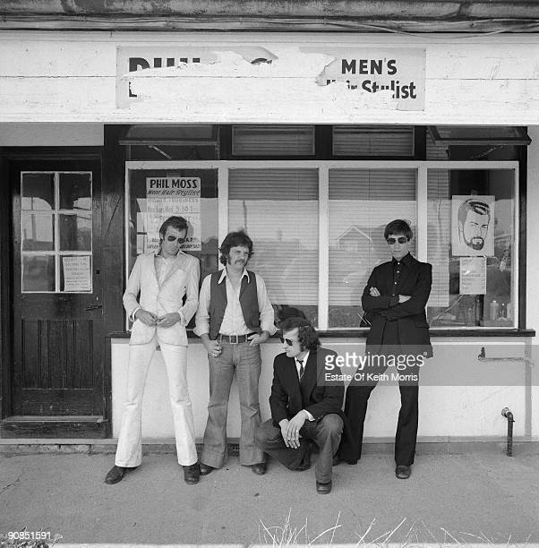 The original lineup of English rock group Dr Feelgood outside a barber's shop on Canvey Island Essex April 1976 Left to right singer Lee Brilleaux...
