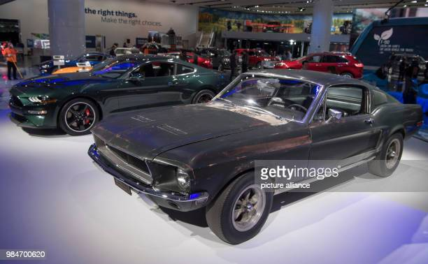 """The original Mustang GT Fastback , which the actor Steve McQueen drove in the """"Bulitt"""" film of 1968, standing beside the new edition of the model..."""