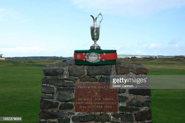 The original Open Championship Belt and the Claret Jug photographed on the commemorative cairn that is placed where the first shot in Open...