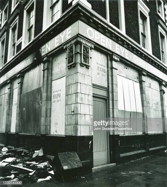 The original Open Eye gallery in Liverpool, boarded up after being fire-bombed whilst showing the work of local photographer John Stoddart, circa...