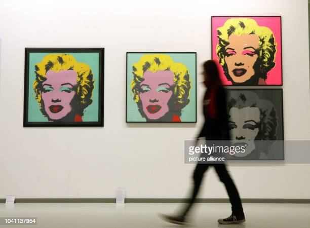 The original print 'Marilyn Monroe' by Andy Warhol  hangs next to an approved copy and misprints in the Ludwiggalerie Schloss Oberhausen in...