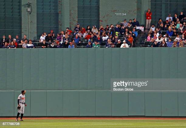 The Orioles' Adam Jones is pictured as he looks up into the centerfield bleachers The Boston Red Sox host the Baltimore Orioles in a regular season...