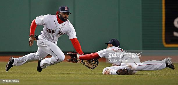 The Orioles' J.J. Hardy hit a ball to right center field in the top of the sixth inning, both Red Sox center fielder Jackie Bradley, Jr. And right...