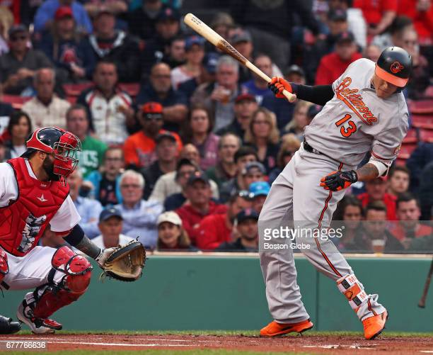 The Orioles' Manny Machado ducks out of the way of a top of the first inning pitch from Red Sox starter Chris Sale that prompted a warning to both...