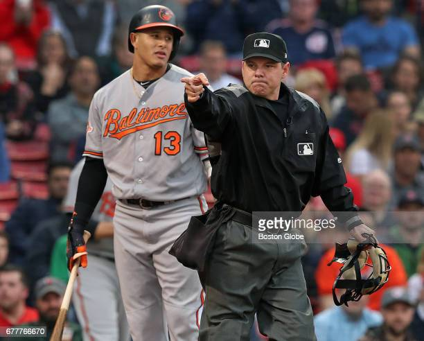 The Orioles' Manny Machado reacts after having to duck out of the way of a top of the first inning pitch from Red Sox starter Chris Sale that...