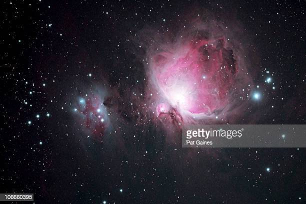 the orion and the running man nebulae - costellazione foto e immagini stock