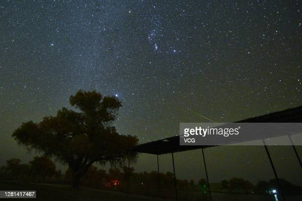 The Orionid meteor shower lights up the night sky at Yuli County on October 21, 2020 in Bayingolin Mongol Autonomous Prefecture, Xinjiang Uygur...
