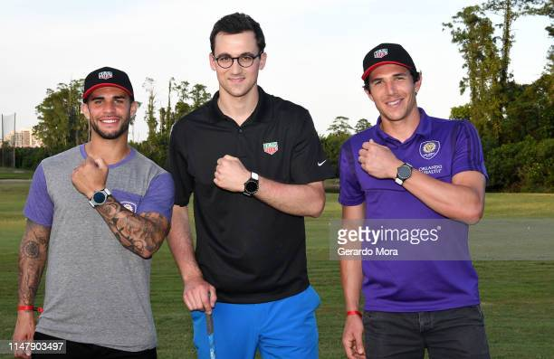 The Orlando City SC players Dom Dwyer Brian Rowe and the Product Manager Tag Heuer Connected Matthieu Soudan pose during the TAG Heuer Connected Golf...