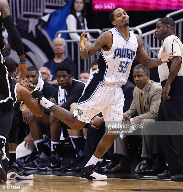 The Orlando Magic's Brandon Jennings gets his foot tangled with the Brooklyn Nets' Markel Brown left at the Amway Center in Orlando Fla on Tuesday...
