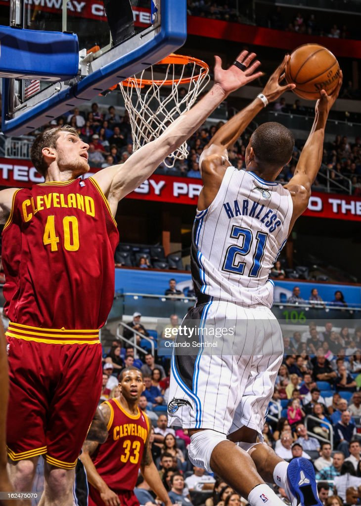 The Orlando Magic's Maurice Harkless (21) goes up to the basket as the Cleveland Cavaliers' Tyler Zeller (40) tries to block during the third quarter at Amway Center in Orlando, Florida, on Saturday, February 23, 2013. Cleveland topped Orlando, 118-94.