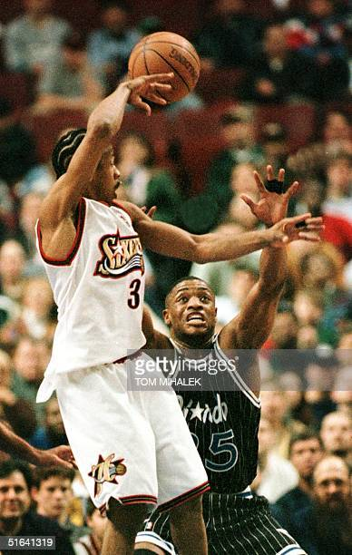 The Orlando Magic's Nick Anderson looks to block the pass of the Philadelphia 76ers Allen Iverson 09 March in Philadelphia The Orlando Magic won 8878...