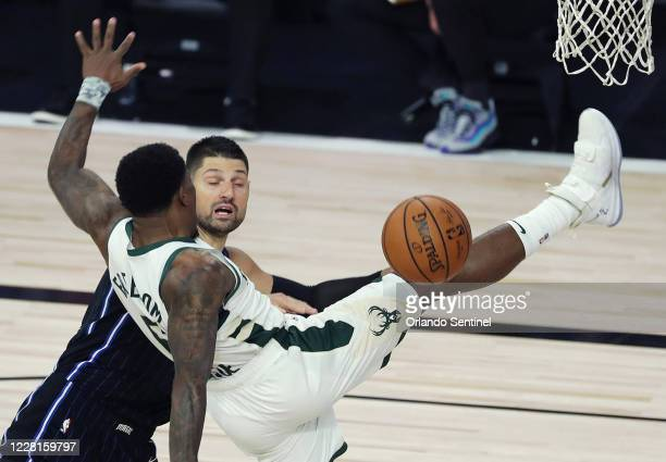 The Orlando Magic's Nikola Vucevic, rear, fouls the Milwaukee Bucks' Eric Bledsoe in Game 3 of the first round of the NBA playoffs at Disneys ESPN...