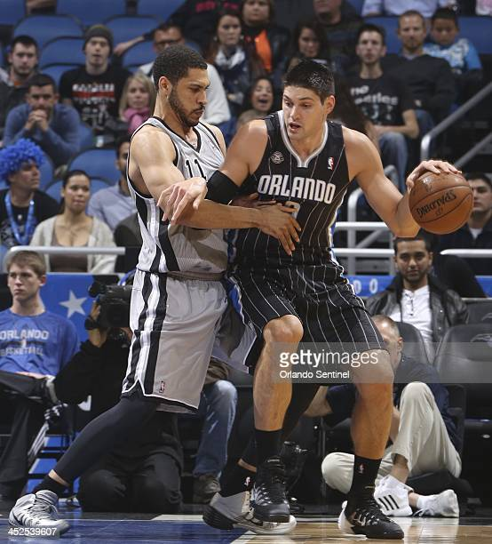 The Orlando Magic's Nikola Vucevic right posts up against the San Antonio Spurs' Jeff Ayres during the first half at the Amway Center in Orlando Fla...