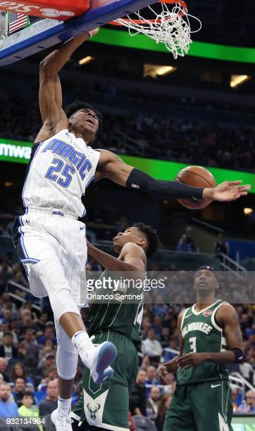 The Orlando Magic's Wes Iwundu dunks over the Milwaukee Bucks' Giannis Antetokounmpo at the Amway Center in Orlando Fla on Wednesday March 14 2018...