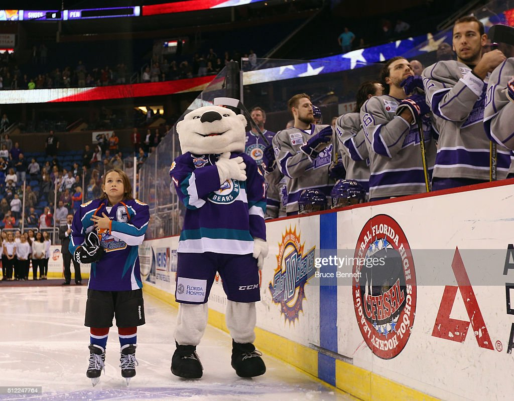 The Orlando Solar Bears mascot 'Shades' and a youth player stand at attention during the national anthem at the Amway Center on February 13, 2016 in Orlando, Florida.