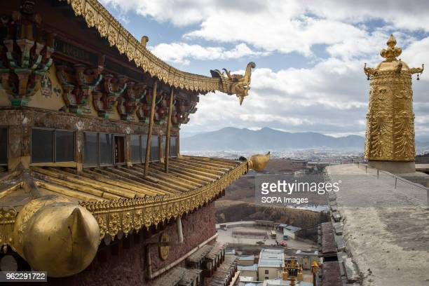 The ornate golden rooftops of the Ganden Sumtsenling Monastery in Shangri-La.