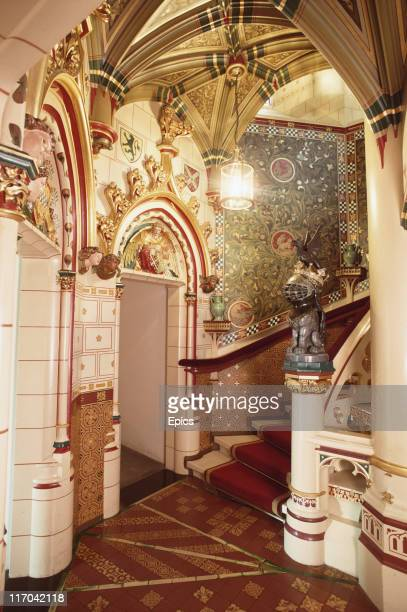 The ornate red stairs designed by architect William Burges in Cardiff Castle Cardiff Wales May 1989
