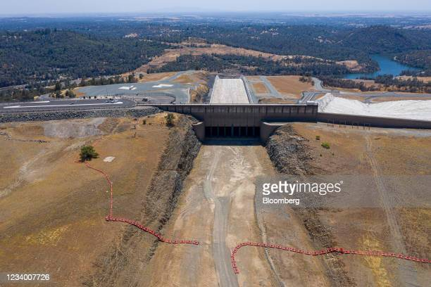 The Oroville Dam spillway at Lake Oroville during a drought in Oroville, California, U.S., on Thursday, July 15, 2021. Water levels at Lake Oroville...