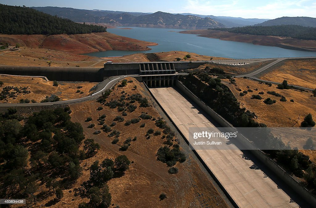 The Oroville Dam spillway stands dry at Lake Oroville on August 19