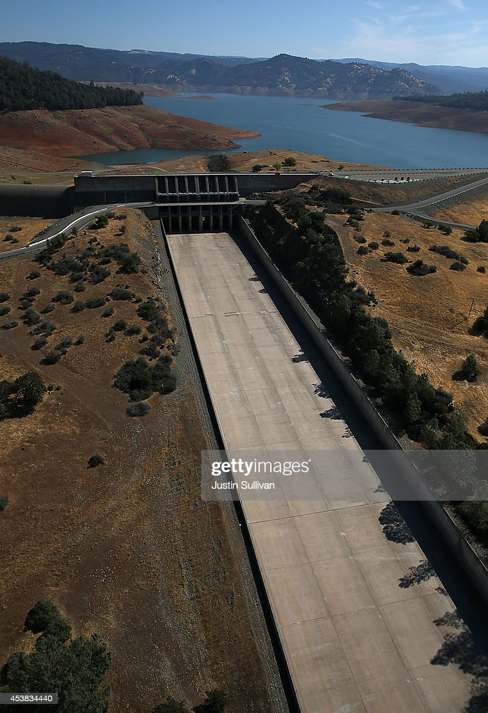 The Oroville Dam spillway stands dry at Lake Oroville on