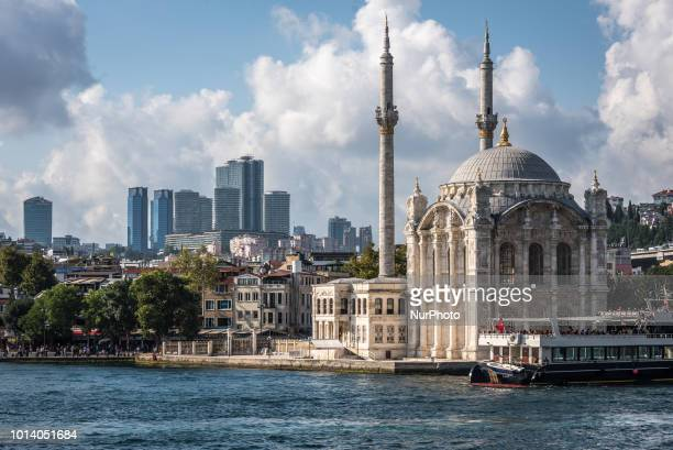 The Ortakoy Mosque rises on the banks of the Bosphorus Strait before the modern skyline of Istanbul, Turkey, on 8 August 2018.