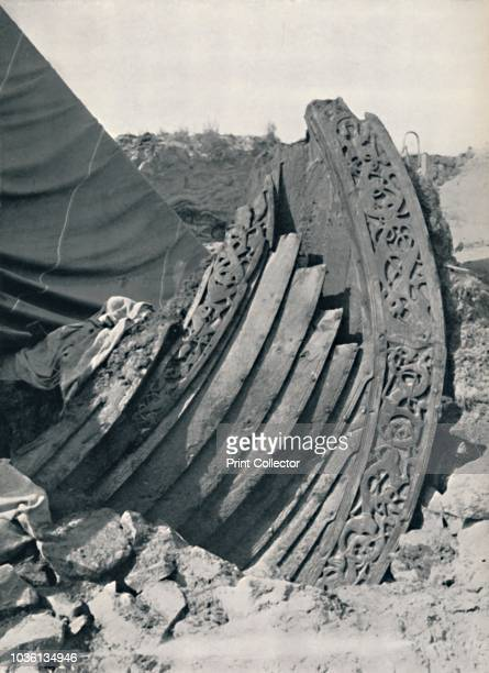 The Oseberg ship in the mound showing the carving on stem and railing' 1935 The Oseberg ship is a wellpreserved Viking ship which was buried c834 AD...