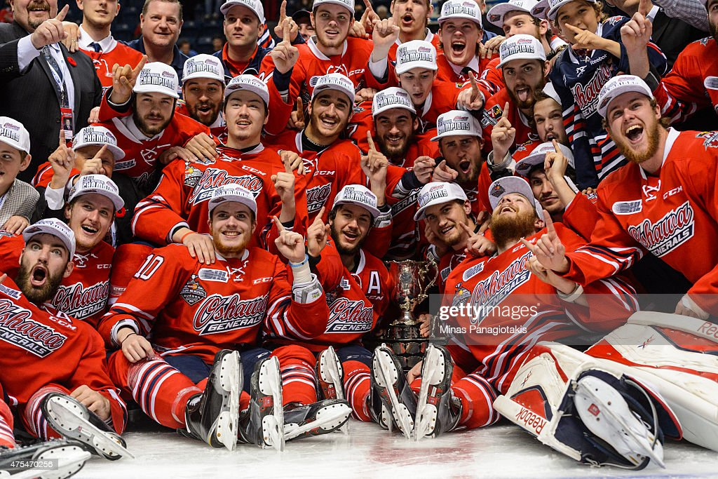The Oshawa Generals pose for a team photo after defeating the Kelowna Rockets and becoming the 2015 Memorial Cup Champions at the Pepsi Coliseum on May 31, 2015 in Quebec City, Quebec, Canada. The Oshawa Generals defeated the Kelowna Rockets 2-1 in overtime and become the 2015 Memorial Cup Champions.