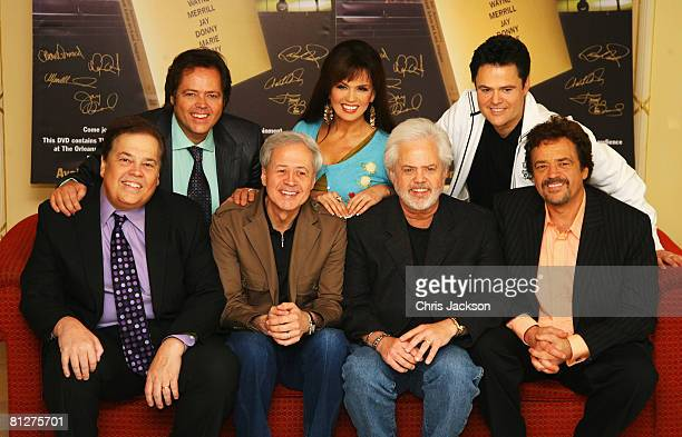 The Osmonds Jimmy Marie Donny Alan Wayne Merril and Jay pose during a photocall promoting their number one DVD and 50th Anniversary Concert in Las...