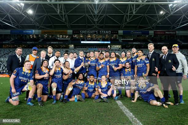 The Otago team and management pose for a photo with the Lin Colling Memorial Trophy after defeating Auckland in the round six Mitre 10 Cup match...
