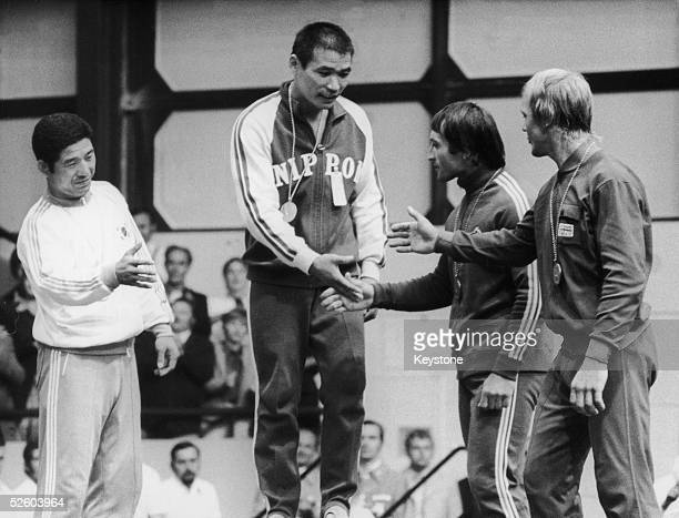 The other winners of the middleweight judo event at the Munich Olympics congratulate Shinobu Sekine of Japan on his gold medal 4th September 1972 Oh...