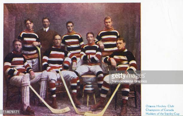 The Ottawa hockey club poses with the Stanley Cup after winning the league championship shown on this postcard Ottawa Ontario Canada c1906