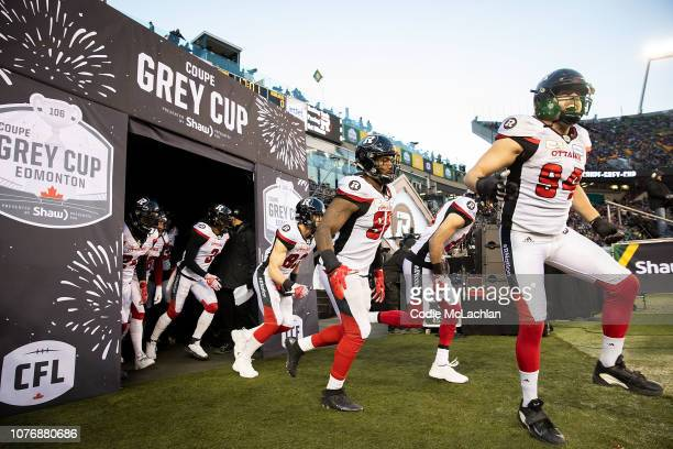 The Ottawa Redblacks come out of the tunnel before the game against the Calgary Stampeders during the Grey Cup at Commonwealth Stadium on November...