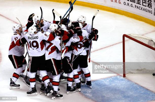 The Ottawa Senators celebrate a gamewinning goal by Bobby Ryan of the Ottawa Senators after he scored against Tuukka Rask of the Boston Bruins during...