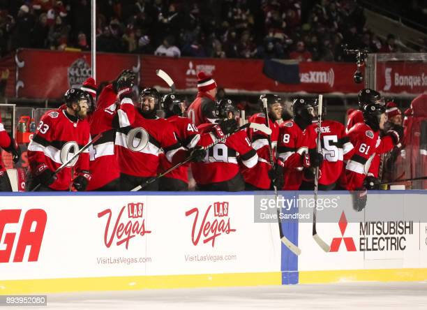 The Ottawa Senators celebrate after a second period goal by JeanGabriel Pageau during the 2017 Scotiabank NHL100 Classic at Lansdowne Park on...