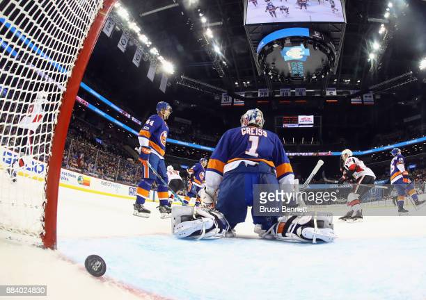 The Ottawa Senators celebrate the first NHL goal by Thomas Chabot against Thomas Greiss of the New York Islanders at the Barclays Center on December...